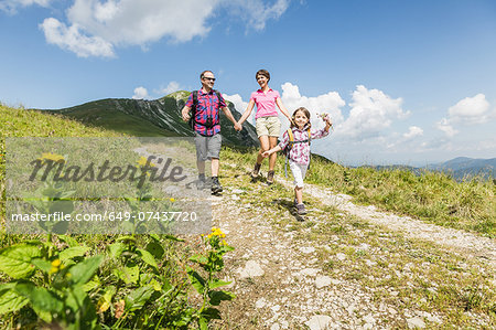 Parents and daughter walking on dirt track, Tyrol, Austria Stock Photo - Premium Royalty-Free, Image code: 649-07437720