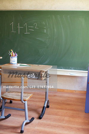Desk and blackboard with sum Stock Photo - Premium Royalty-Free, Image code: 649-07437854