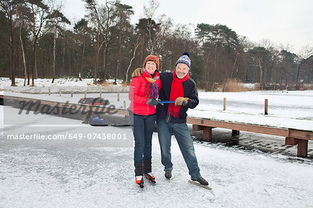 Couple ice skating, holding hands Stock Photo - Premium Royalty-Free, Image code: 649-07438001