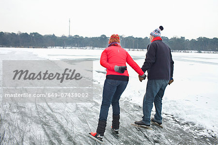 Couple ice skating, holding hands Stock Photo - Premium Royalty-Free, Image code: 649-07438002