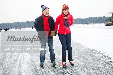 Couple ice skating, holding hands Stock Photo - Premium Royalty-Free, Image code: 649-07438003