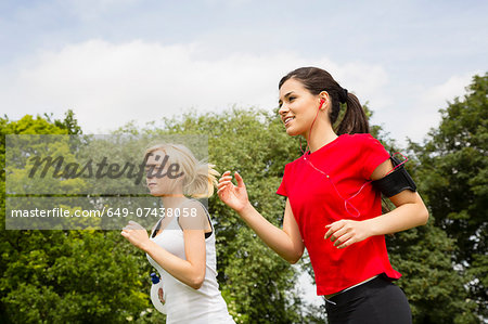 Women jogging through park Stock Photo - Premium Royalty-Free, Image code: 649-07438058