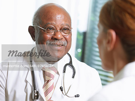 Senior doctor with female patient Stock Photo - Premium Royalty-Free, Image code: 649-07438114