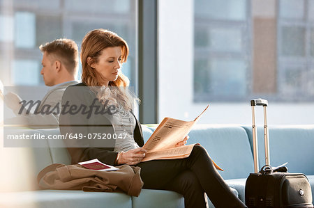 Businesswoman in departure lounge Stock Photo - Premium Royalty-Free, Image code: 649-07520047
