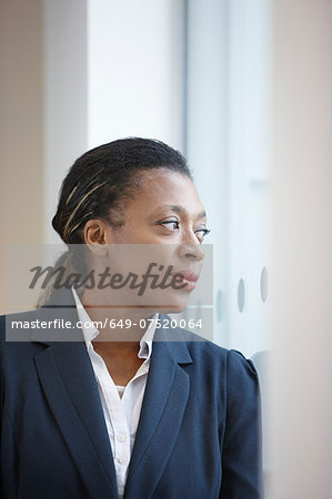 Portrait of businesswoman looking away Stock Photo - Premium Royalty-Free, Image code: 649-07520064