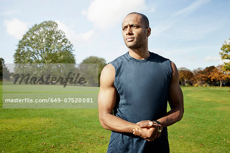 Man standing in park Stock Photo - Premium Royalty-Free, Image code: 649-07520081