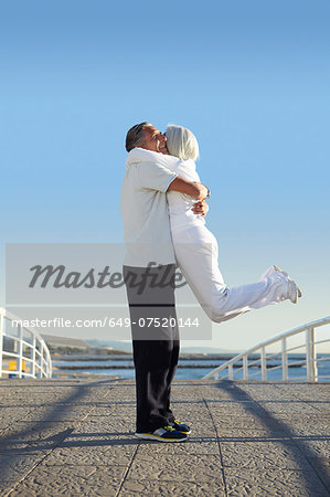 Man lifting woman up Stock Photo - Premium Royalty-Free, Image code: 649-07520144