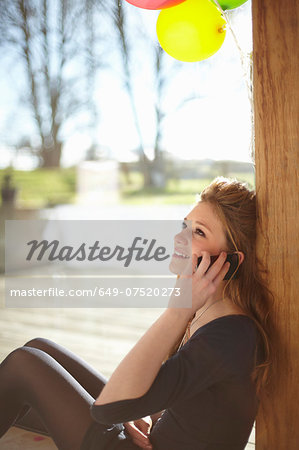 Teenage girl talking on mobile at birthday party Stock Photo - Premium Royalty-Free, Image code: 649-07520273