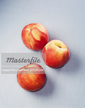 Still life of three peaches Stock Photo - Premium Royalty-Free, Image code: 649-07520286