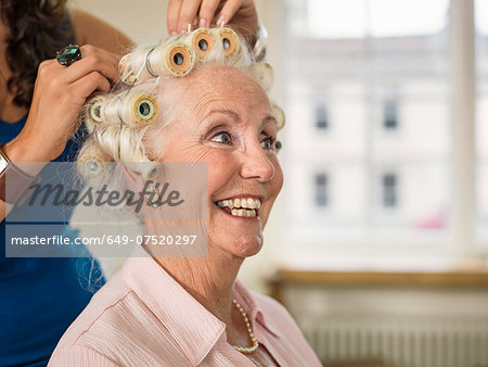 Senior woman with rollers at hairdressers Stock Photo - Premium Royalty-Free, Image code: 649-07520297
