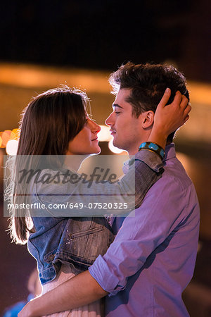 Young couple embracing at night, Paris, France Stock Photo - Premium Royalty-Free, Image code: 649-07520325