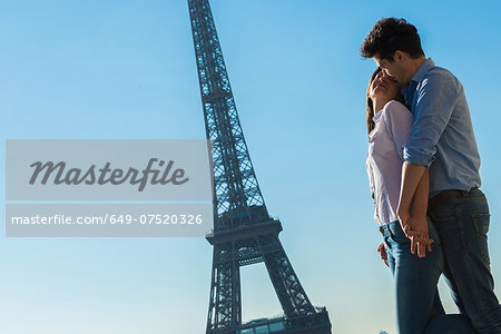 Young couple embracing near Eiffel Tower, Paris, France Stock Photo - Premium Royalty-Free, Image code: 649-07520326