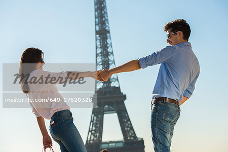 Young couple in front of  Eiffel Tower, Paris, France Stock Photo - Premium Royalty-Free, Image code: 649-07520328