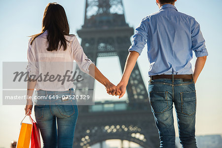 Young couple strolling in front of  Eiffel Tower, Paris, France Stock Photo - Premium Royalty-Free, Image code: 649-07520329