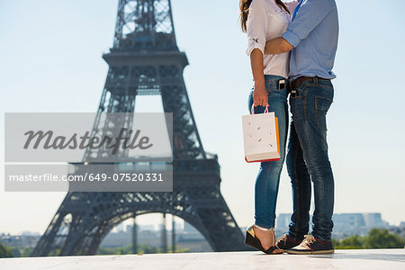 Young couple embracing in front of  Eiffel Tower, Paris, France Stock Photo - Premium Royalty-Free, Image code: 649-07520331