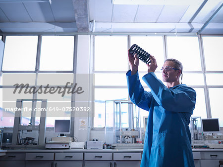 Worker inspecting spring in laboratory Stock Photo - Premium Royalty-Free, Image code: 649-07520392