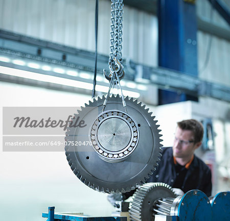 Gear for industrial gearbox in engineering factory Stock Photo - Premium Royalty-Free, Image code: 649-07520470