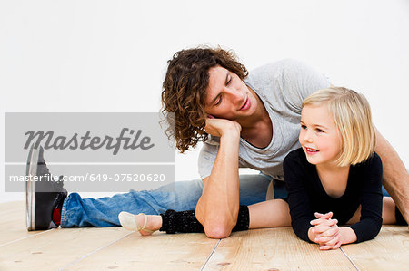 Studio shot of father posing with ballerina daughter Stock Photo - Premium Royalty-Free, Image code: 649-07520620