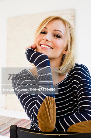Studio portrait of young woman in stripes Stock Photo - Premium Royalty-Free, Image code: 649-07520630