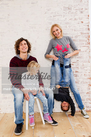 Studio portrait of couple waving fun with son and daughter Stock Photo - Premium Royalty-Free, Image code: 649-07520647