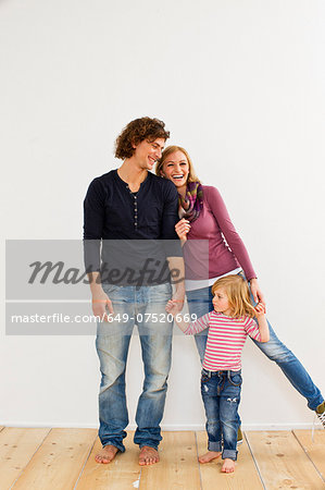 Studio shot of couple holding hands with young daughter Stock Photo - Premium Royalty-Free, Image code: 649-07520669