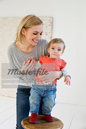 Studio portrait of mother holding baby daughter Stock Photo - Premium Royalty-Free, Image code: 649-07520673
