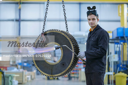 Portrait of engineer heat treating industrial gear in factory Stock Photo - Premium Royalty-Free, Image code: 649-07520719