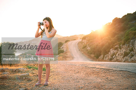 Girl taking photographs at sunset, Kas, Turkey Stock Photo - Premium Royalty-Free, Image code: 649-07520778