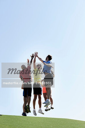 Mature trainer celebrating with group of adults Stock Photo - Premium Royalty-Free, Image code: 649-07520931
