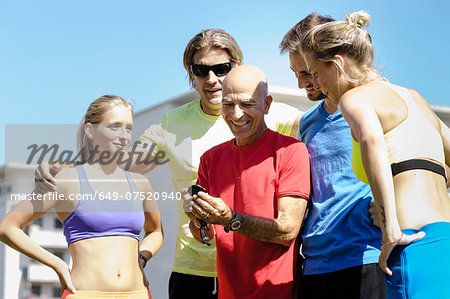 Mature male trainer and a group of adult runners Stock Photo - Premium Royalty-Free, Image code: 649-07520940