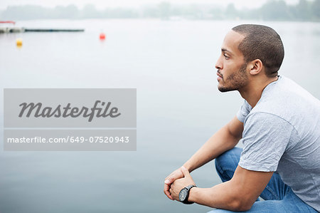 Portrait of young man by lake Stock Photo - Premium Royalty-Free, Image code: 649-07520943
