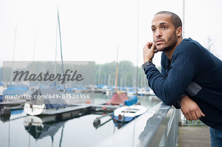 Portrait of young man in marina Stock Photo - Premium Royalty-Free, Image code: 649-07520956