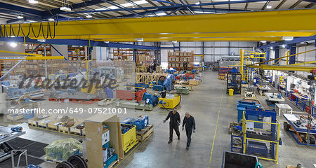 High angle view of workers in engineering factory Stock Photo - Premium Royalty-Free, Image code: 649-07521001