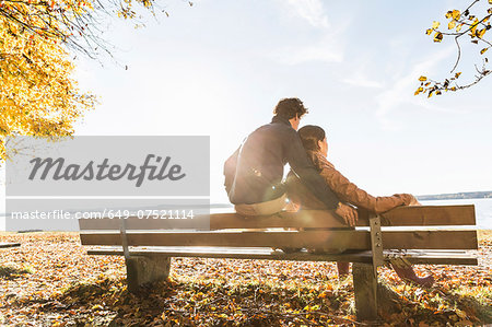 Couple sitting on bench, rear view Stock Photo - Premium Royalty-Free, Image code: 649-07521114