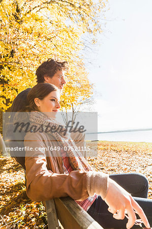 Couple sitting on bench Stock Photo - Premium Royalty-Free, Image code: 649-07521115