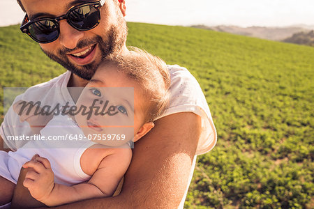 Portrait of baby girl and proud father Stock Photo - Premium Royalty-Free, Image code: 649-07559769