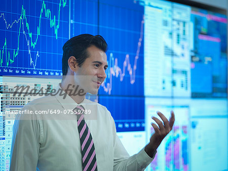 Businessman in front of presentation on graphical screens Stock Photo - Premium Royalty-Free, Image code: 649-07559789