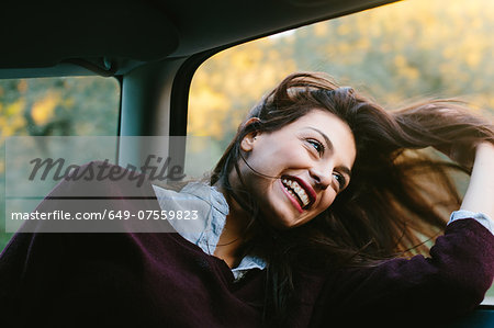 Young woman enjoying car ride Stock Photo - Premium Royalty-Free, Image code: 649-07559823