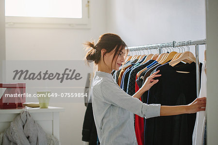 Young woman getting ready to go out Stock Photo - Premium Royalty-Free, Image code: 649-07559854