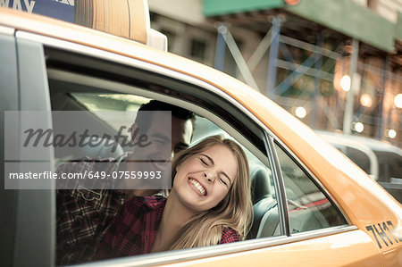 Young couple laughing in yellow cab, New York City, USA Stock Photo - Premium Royalty-Free, Image code: 649-07559993