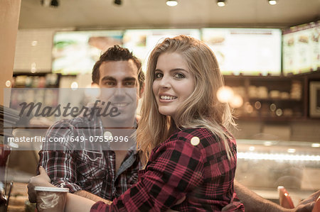 Young couple looking out of cafe window Stock Photo - Premium Royalty-Free, Image code: 649-07559996