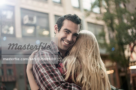 Happy young couple hugging on street, New York City, USA Stock Photo - Premium Royalty-Free, Image code: 649-07560000
