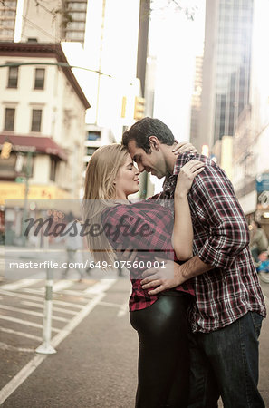Romantic young couple hugging on street, New York City, USA Stock Photo - Premium Royalty-Free, Image code: 649-07560001