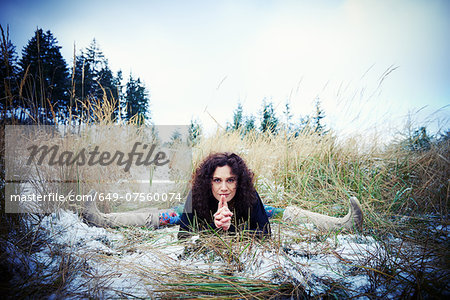 Mid adult woman practicing the splits in forest Stock Photo - Premium Royalty-Free, Image code: 649-07560074