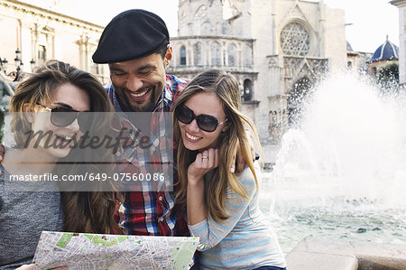 Tourist friends looking at map, Plaza de la Virgen, Valencia, Spain Stock Photo - Premium Royalty-Free, Image code: 649-07560086