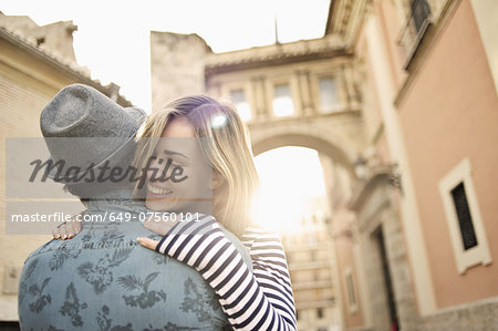 Young couple hugging, Valencia, Spain Stock Photo - Premium Royalty-Free, Image code: 649-07560101