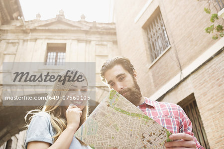 Young tourist couple looking at map outside Valencia Cathedral, Valencia, Spain Stock Photo - Premium Royalty-Free, Image code: 649-07560105