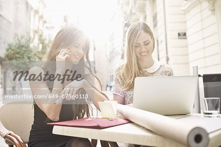 Two young female friends taking a break at sidewalk cafe, Valencia, Spain Stock Photo - Premium Royalty-Free, Image code: 649-07560110