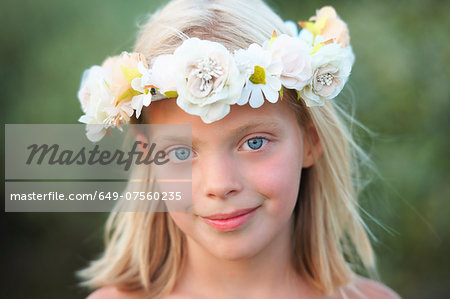 Portrait of girl with flower garland in her hair Stock Photo - Premium Royalty-Free, Image code: 649-07560235