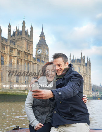 Mature tourist couple photographing selves and Houses of Parliament, London, UK Stock Photo - Premium Royalty-Free, Image code: 649-07560242